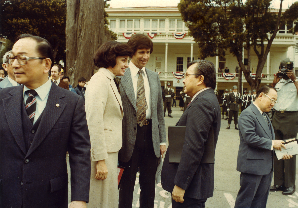 Mayor Feinstein and husband Richard Blum speak with Senator Inouye at opening